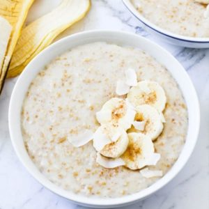 two bowls of banana maple steel cut oats topped with banana slices