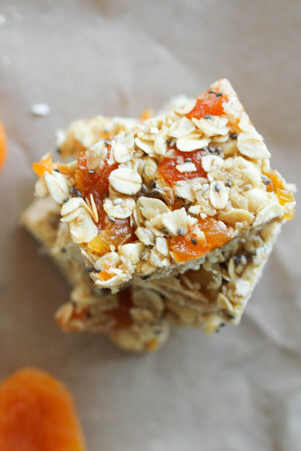 chewy apricot muesli bars stacked on top of each other