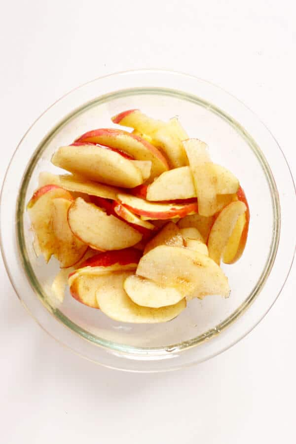 sliced apples in a glass bowl