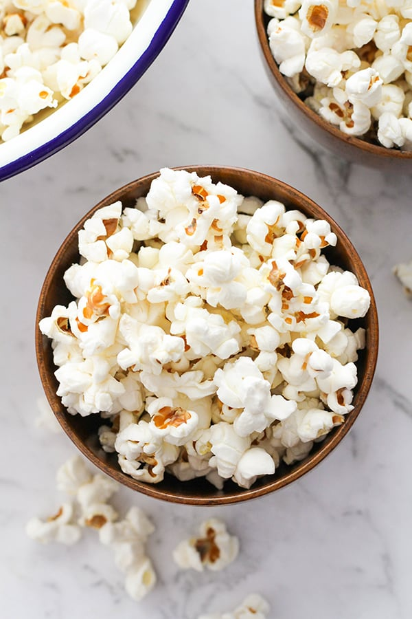 popcorn in a wooden bowl.