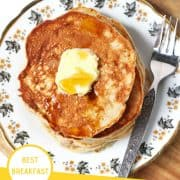 """healthy banana pancakes on a pattered plate with butter and maple syrup on top with a text overlay that reads """"healthy banana pancakes - best breakfast"""""""