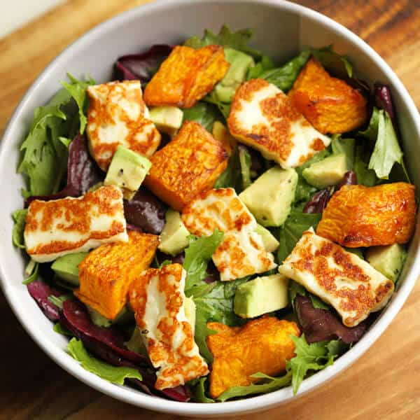 pumpkin, haloumi and avocado salad in a bowl