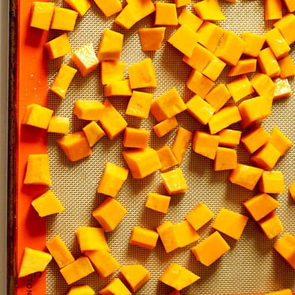 diced pumpkin on a baking tray