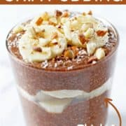 chocolate chia pudding in a glass cup topped with banana slices and almonds.