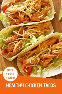 "3 tacos on a wooden board with a text overlay that reads ""healthy chicken tacos - quick & easy dinner"""