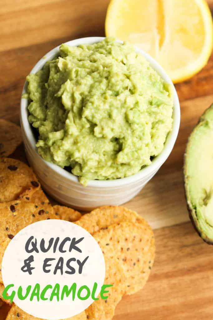 """guacamole in a white bowl surrounded by corn chips with text overlay """"quick & easy guacamole"""""""
