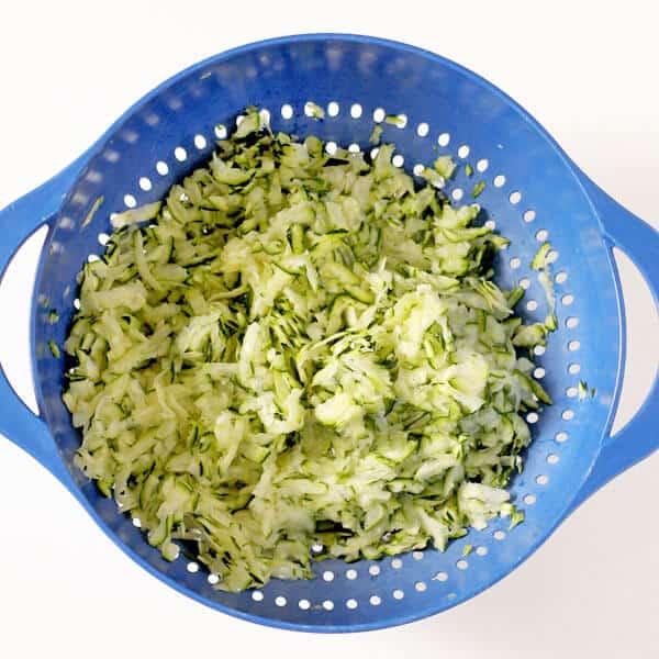 grated zucchini in a colander