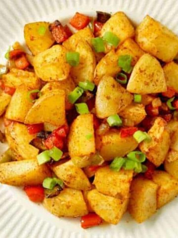 close up on a plate of crispy breakfast potatoes