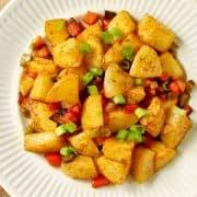 crispy breakfast potatoes on a white plate