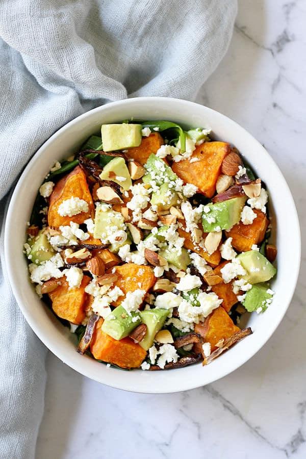 sweet potato, avocado and feta salad in a white bowl