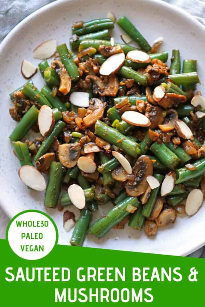 "sauteed green beans and mushrooms on a white plate with a text overlay that reads ""sauteed green beans & mushrooms - whole30, paleo & vegan"""