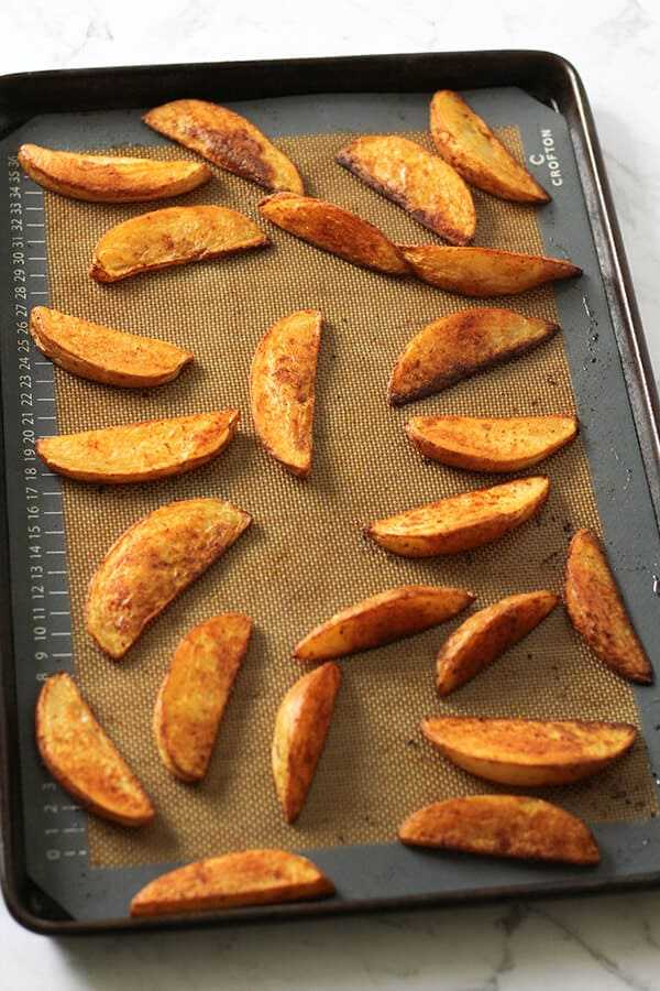 potato wedges on a baking tray.