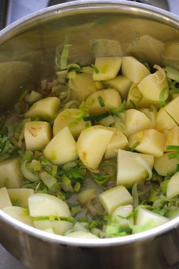 potato and leek soup ingredients in a saucepan.