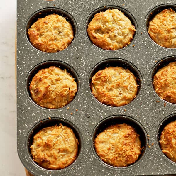 banana coconut muffins sitting in muffin tray
