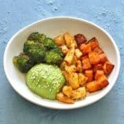 sheet pan cajun chicken and sweet potato bowls