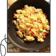 """scrambled eggs on toast with text overlay """"the BEST scrambled eggs""""."""