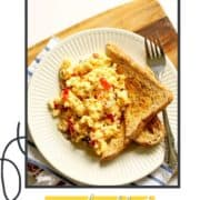 """scrambled eggs on toast with text overlay """"cheesy loaded scrambled eggs""""."""