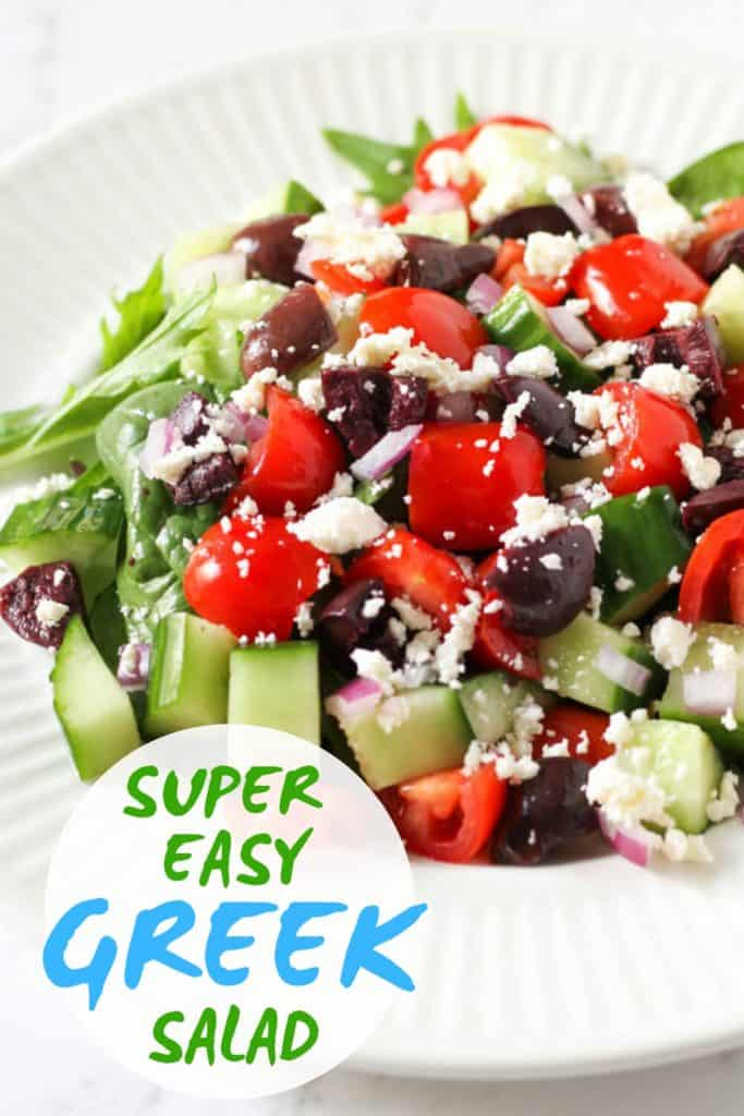 "close up image of greek salad with text overlay that reads ""super easy greek salad"""