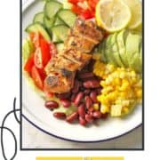 """salad on a plate with text overlay """"mexican chicken salad""""."""