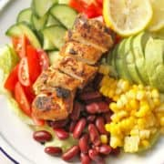 """salad on a plate with text overlay """"quick & easy mexican chicken salad""""."""