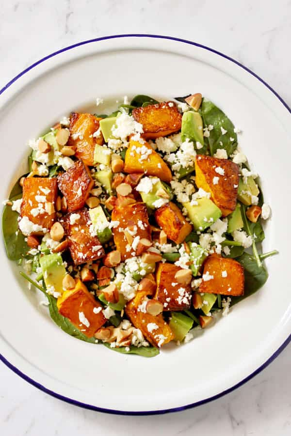 roast pumpkin, spinach and feta salad on a white plate