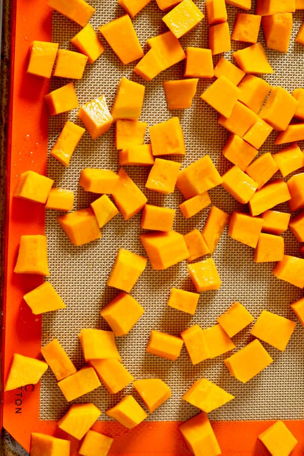pumpkin pieces on a roasting tray