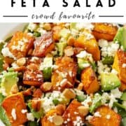 "salad in a white bowl with text overlay ""pumpkin & feta salad""."