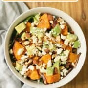 "salad in a bowl with text overlay ""sweet potato and feta salad""."
