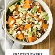 "salad in a bowl with text overlay ""roasted sweet potato salad""."