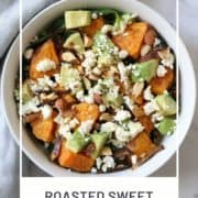 "salad in a bowl with text overlay ""roasted sweet potato and feta salad""."
