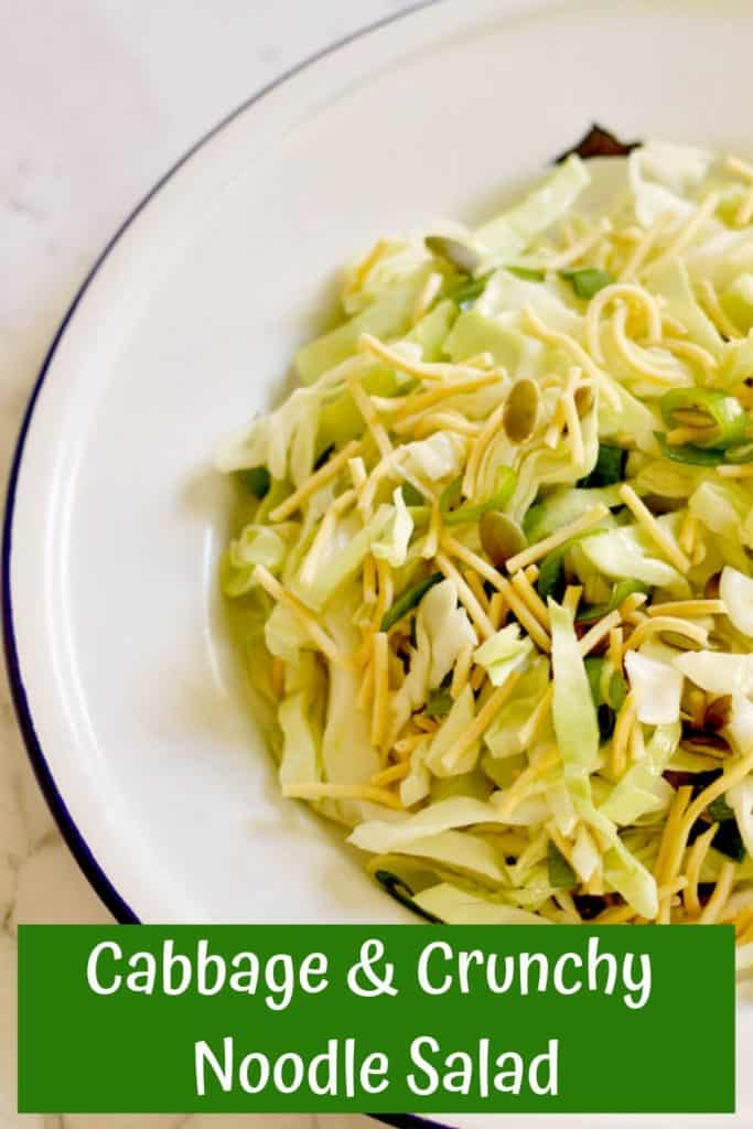cabbage and crunchy noodle salad on a white plate