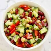 middle eastern bean salad in a white bowl