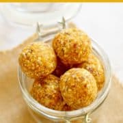 apricot coconut energy balls in a glass jar.
