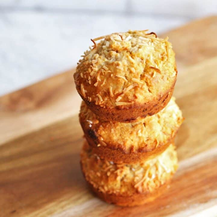 banana coconut muffins stacked on top of each other.