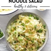"salad in a large grey bowl with text overlay ""cabbage & crunchy noodle salad""."