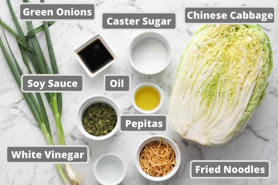 cabbage salad ingredients including soy sauce, olive oil and fried noodles.