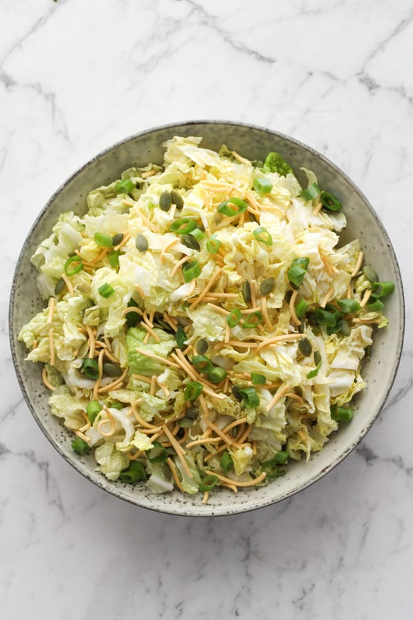 cabbage and crunchy noodle salad in a large bowl.