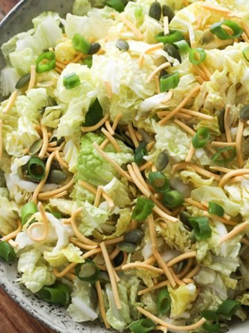 cabbage and crunchy noodle salad in a large grey bowl.