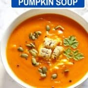 """soup topped with croutons with text overlay """"fall favorite pumpkin & sweet potato soup""""."""