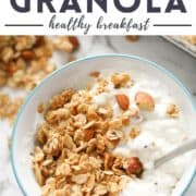 """bowl of yoghurt topped with granola with text overlay """"honey almond granola""""."""