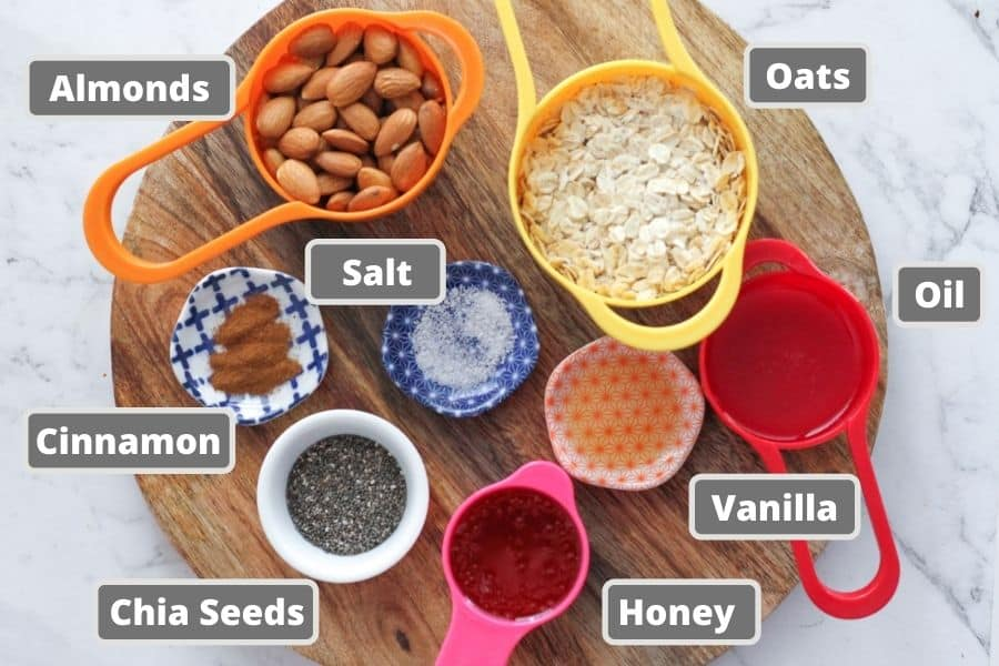 ingredients for honey almond granola including oats, almonds and honey.