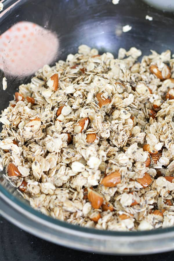 granola ingredients in a glass bowl.