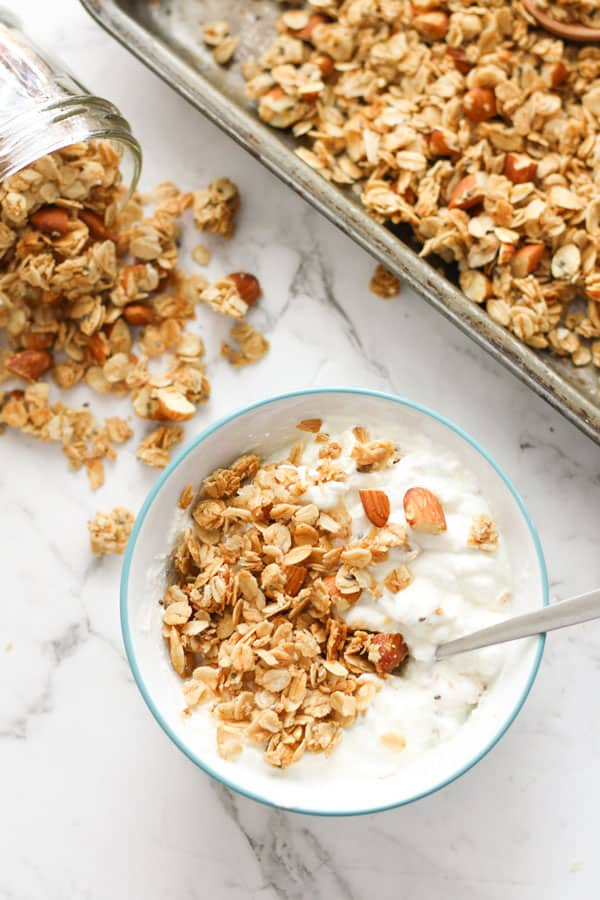 bowl of yoghurt topped with granola.