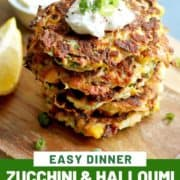 """fritters stacked on top of each other with text overlay """"zucchini & halloumi fritters""""."""