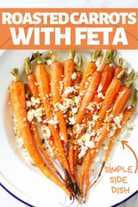roasted dutch carrots with feta and dukkah on a white plate.