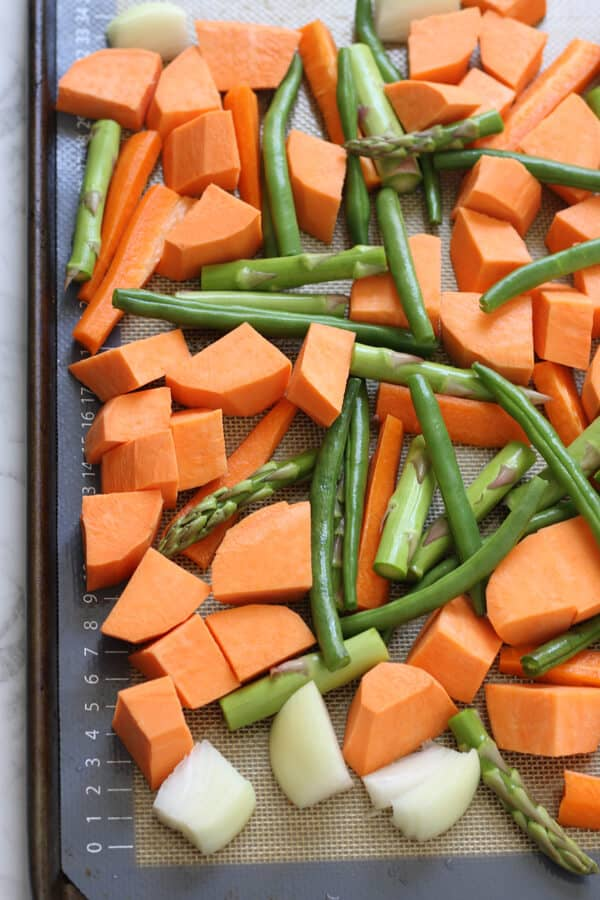 assorted vegetables on a baking tray