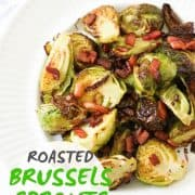 "roasted brussels sprouts with bacon on a white plate with text overlay that reads ""roasted brussels sprouts with bacon"""
