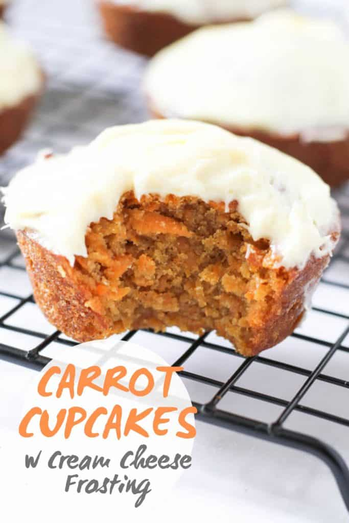 """picture of a frosted cupcake with a bite removed with text overlay that reads """"carrot cupcakes w cream cheese frosting"""""""