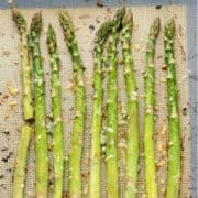 roasted asparagus spears on a baking tray