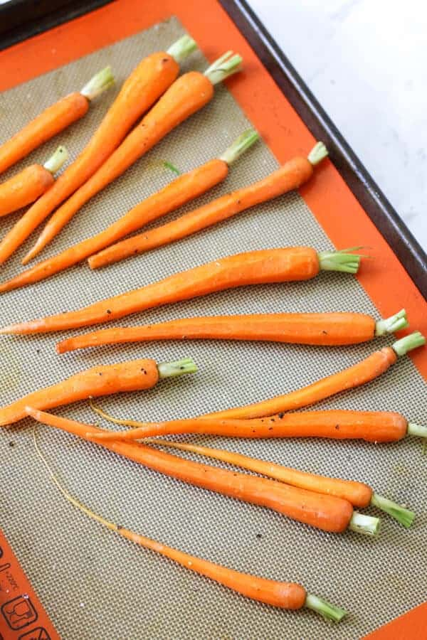 raw carrots on a baking tray